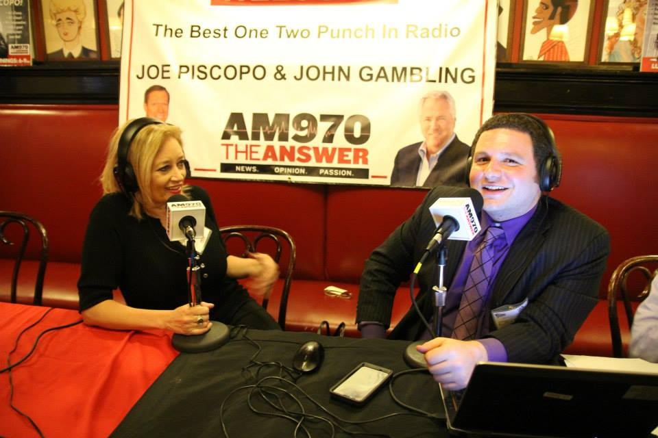 Here's Debbie with Frank Morano at a live radio event for AM 970 at Sardi's in New York City